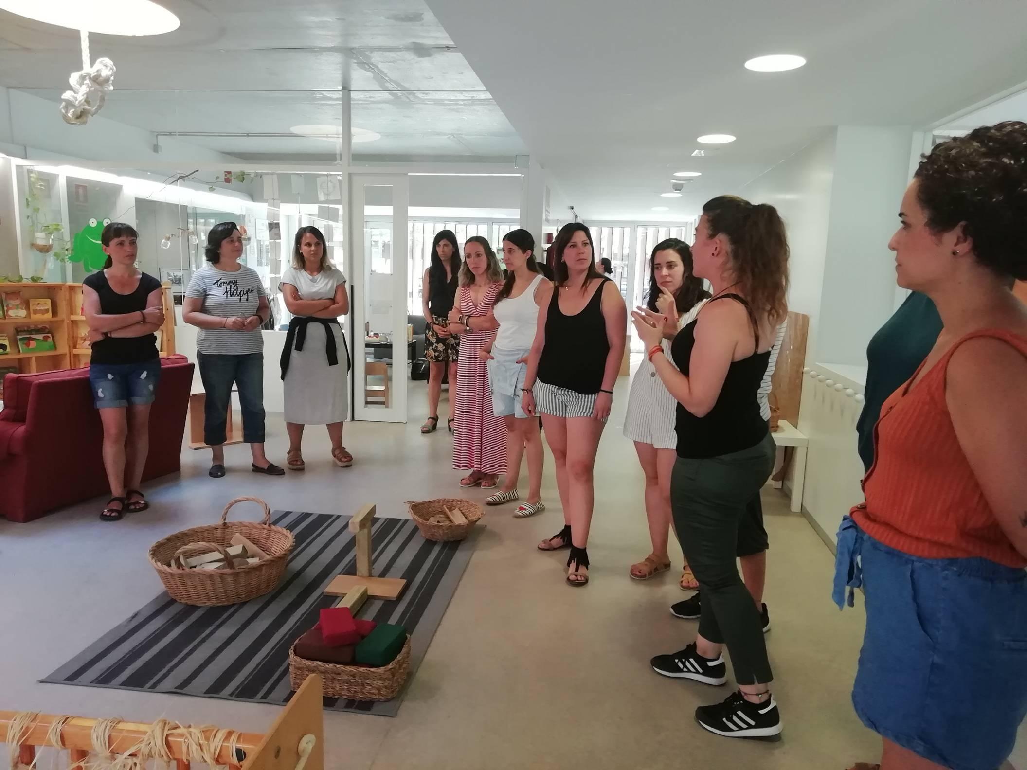 Educadores de l'Arc de Sant Martí i la Granota a la visita realitzada el 9 de juliol.